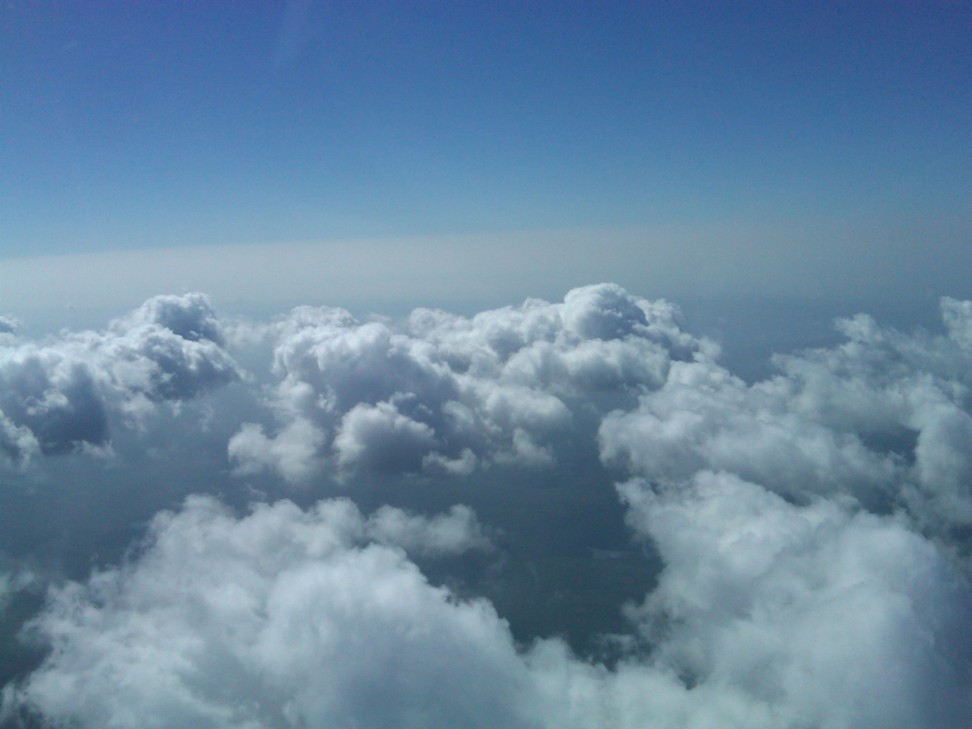 flying on top of cumulus clouds