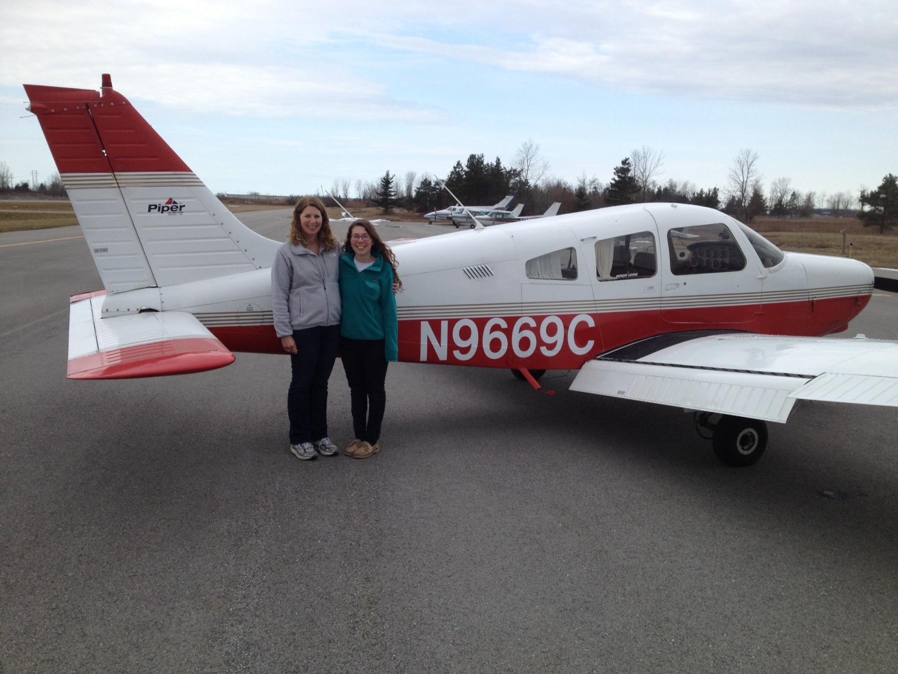 Lisa and her daughter Becky next to airplane Lisa took her flight test in